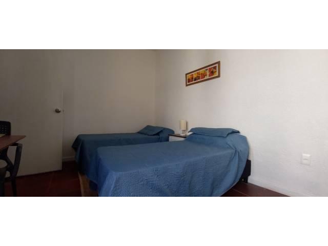 Dormitorio independiente en suite