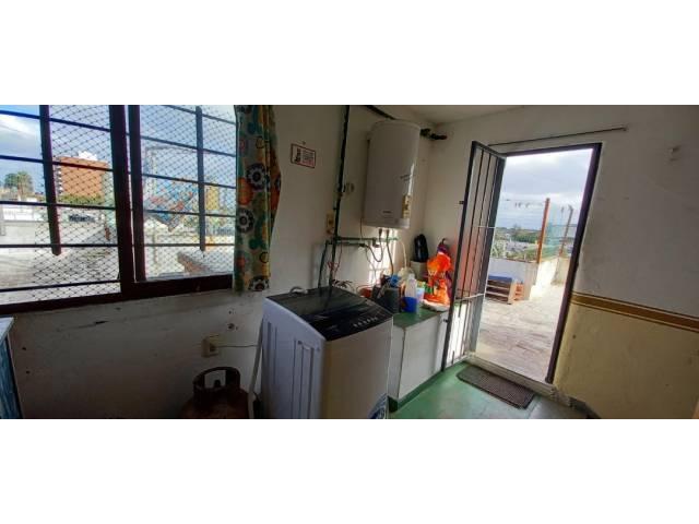 Habitación lavadero con salida a azotea